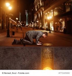 Businessman on knees on the street found treasure underground